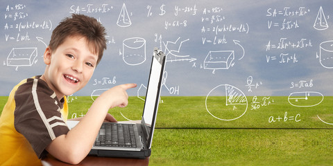 Young boy with laptop computer.
