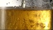 Process of pouring light beer into a glass