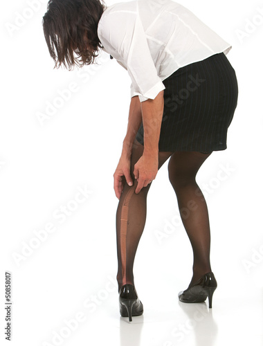 Business woman with run in stocking.