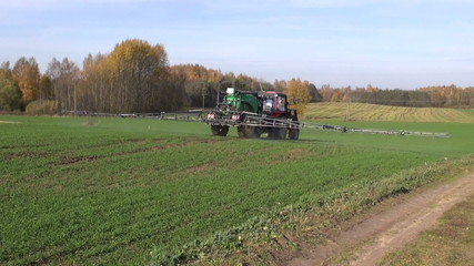 agriculture tractor spraying crop field
