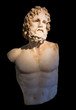Statue of god Asclepius with selective lighting