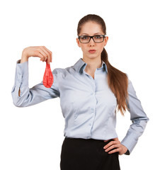 Woman in glasses holding a deflated balloon
