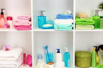 Bath accessories on shelfs in bathroom