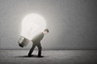Businessman carry bright light bulb