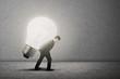 Businessman carry bright light bulb