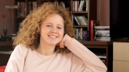 Portrait of blond curly hair teenager  - tracking shot