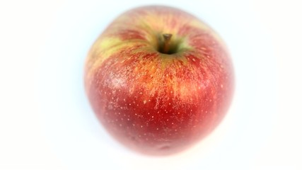 A rotary juicy red apple on a white background