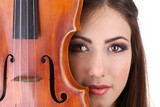 Beautiful young girl with violin, close up