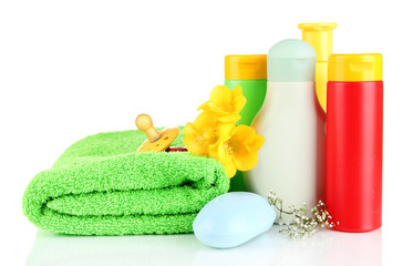 Baby cosmetics, towels and soap, isolated on white