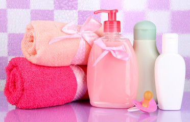 Baby cosmetics and towels  in bathroom