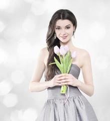 Beautiful brunette woman with tulip bouquet