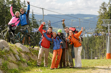 Happy hikers reaching their goal mountain top