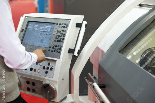 man working at programmable machine