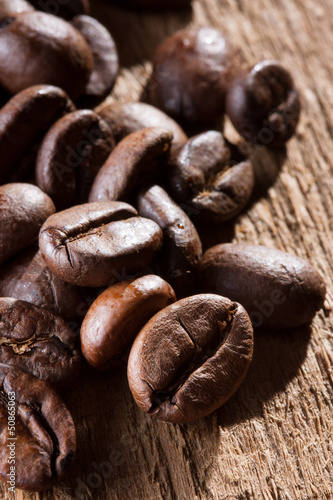 Coffee grains over wooden table