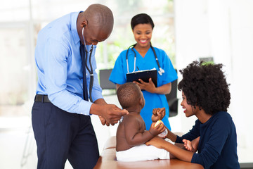pediatric doctor examining a child