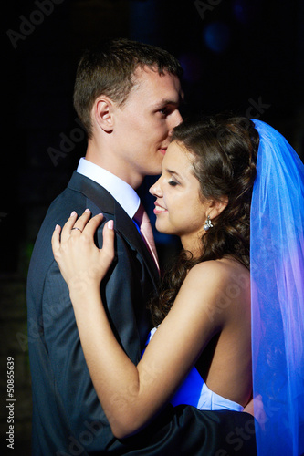 Romantic dance young bride and groom