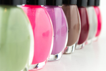Group of bright nail polishes on white