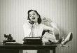 Woman talking on phone at desk - 50866246