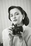 Beautiful business woman with a old camera