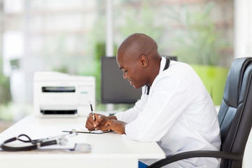 african medical doctor writing reports