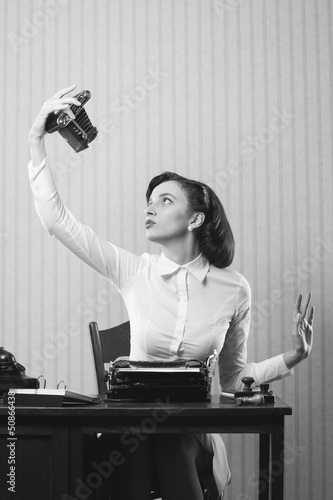 Beautiful business woman taking a picture of herself with a old