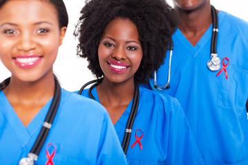 african healthcare workers with red ribbon