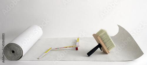 Leinwanddruck Bild Weisse Tapetenrolle auf weissem Hintergrund.