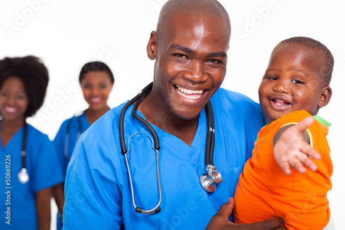 african pediatric doctor playing with baby boy