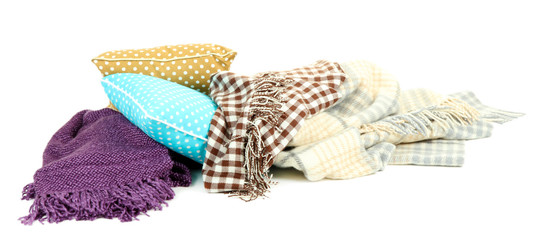 Plaids and color pillows, isolated on white