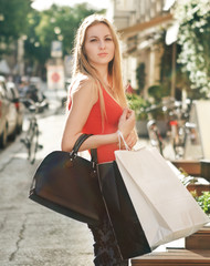 Woman with shopping bags outdoors