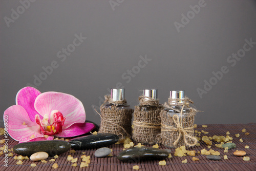 Spa oil on bamboo mat on bright background