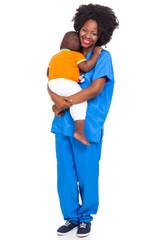 Black paediatric nurse with child