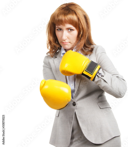 Young businesswoman wearing boxing gloves