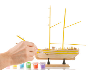 Model sailing ship on white