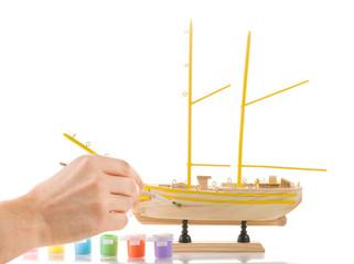 Model sailing ship on white