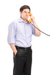 Angry man having a telephone conversation
