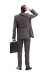 Full length portrait of a businessman with briefcase, holding hi