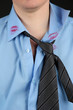 Lipstick kiss on shirt collar of man, isolated on black