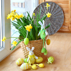 Narcissus with an happy easters rabbits and egg on a window