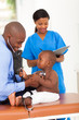 cute african little patient pulling doctor stethoscope