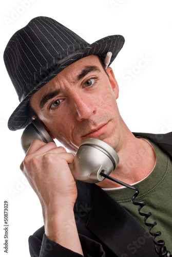 Caucasian male wearing a hat on phone
