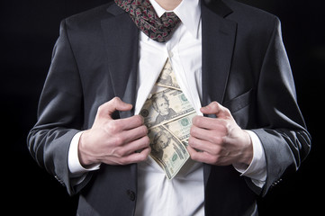 Concept businessman pulling back his shirt exposing money