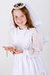 Young girl in First Communion Attire with rosary beads
