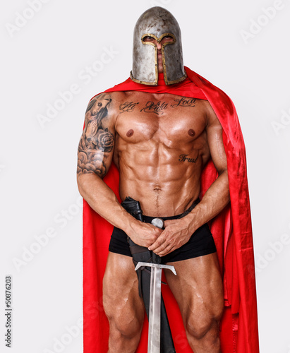 Brave well looking warrior in red mantle and helmet
