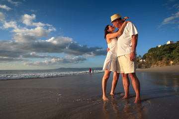 Loving senior couple on  tropical beach