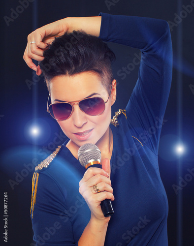 Stylish singing girl with blue lights