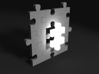 Jigsaw puzzle piece lights in the dark