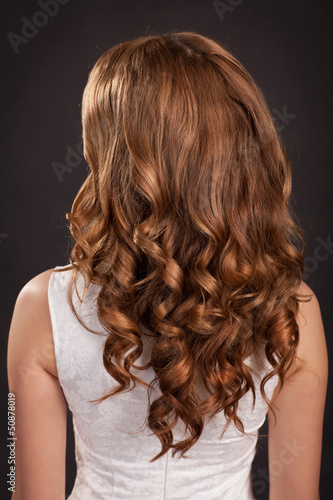 Beautiful long hair Brunette woman with curly hairstyle