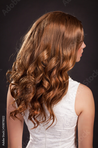 Beautiful long Brunette hairs woman with curly hairstyle