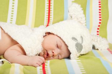 Sleeping little baby with bunny cap